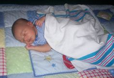 My son Jaleel...Baby on side and with a blanket uh oh...not safe