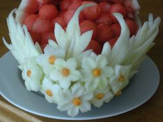 Inspiration picture, no instructions. The white flowers and leaves could be cut out of jicama and held onto a small watermelon with toothpicks or the white of the watermelon rind Edible Fruit Arrangements, Edible Bouquets, Veggie Art, Fruit And Vegetable Carving, Edible Food, Edible Art, Watermelon Flower, Watermelon Bowl, Fruits Decoration