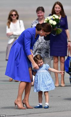Charlotte pauses on the tarmac to point something out to her mother...