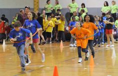 relay race for kids.   The teams have to run to a check point and back  in groups.  What's the catch?  They have to run together inside of a Hula Hoop.  If the Hula Hoop falls down to the ground, the group has to start back at the starting point.