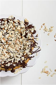 flourless almond cake with chocolate drizzle and almonds, (gluten-free).