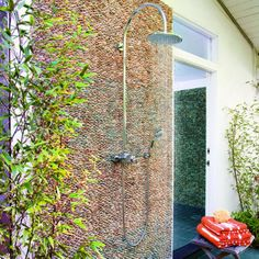 Pebble wall - Great Outdoor Showers - Sunset