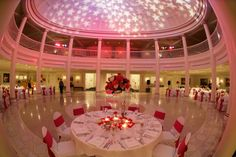 The domed ceiling and polished dance floor make the American Adventure Rotunda in Epcot a regal venue choice #Disney #pink