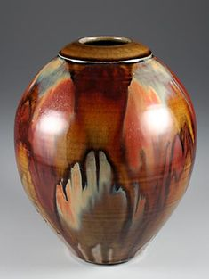 A thrown vase with a temmoku glaze as a base, plus brush strokes over top in iron, rutile and titanium. This piece was fired very hot — at least cone 12, and the glaze and brush strokes have flowed together nicely with the extra heat. It stands 28 cm high and was made in the early 1990s