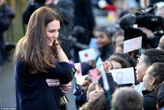 Warm welcome: The Duchess of Cambridge was cheered as she went to leave by a crowd of excited children