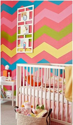 Colorful painted walls for nursery by using multi-colored zig-zagged lines.