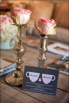 Roses in silver vases would coordinate well with silver tea service & pink rose teacups.