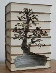 Bonsai tree carved into old books, by Kylie Stillman
