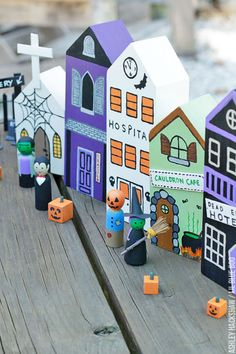 How to Paint a DIY Halloween Village set for spooky table or window decor. Halloween Village with peg dolls, cemetery and pumpkins.