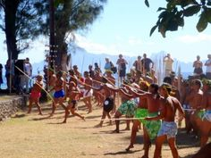 Male spear throwers during Heiva I Tahiti, French Polynesia