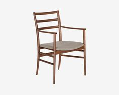 Scandinavian Designs - The Lofia dining chair is an architectural beauty with a mix of straight and gently curving lines. This refined choice will dress up your dining space with a warm wood frame and complementary fabric seat.