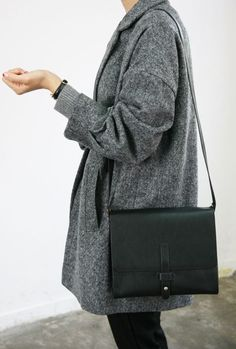 classic minimalistic style, simple coat and black satchel