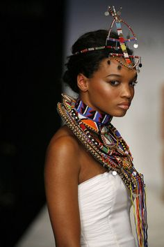A model from Kevan Halls Fashion show wearing a traditional African beadwork necklace