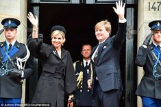 Maxima looked chic but fashion-forward in a black coat with voluminous sleeves and unusual...