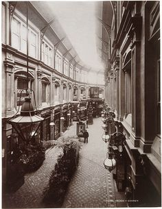 The Royal Arcade, Sydney, ran from George Street near the markets, through to Pitt Street, near the School of Arts. Over 90 metres long, it was well lit, with a lofty celestory and gas lamps. There were 31 shops on the ground floor, 36 offices on the first floor and a photographic studio above them at the George Street end. Of Sydney's five Victorian arcades, only the Strand survived twentieth century development. Photo: 1892.