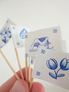 Delft Blue Cupcake Toppers are an adorable way to decorate cupcakes and appetizers for the reception.  I found these from Etsy seller Martice Supplies