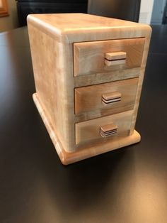 "Here are a few pics of the M-50 ""The Three Drawers"" Puzzle Box by Akio Kamei offered on a recent lottery. Pointed out as not overly complex, you do have to admit that it is a beautiful puzzle! A special thank you to Damir for sharing. #AkioKamei #Karakuri #PuzzleBoxWorld #ThreeDrawers #WoodCraft #Tochi #PuzzleBox #Japan"