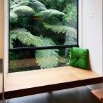 window seat in front of glass ... living room?