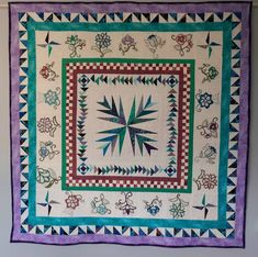 Medallion Art quilt, wall hanging, table cloth, or lap quilt with embroidered Jacobean flowers, turquoise, lilac, white