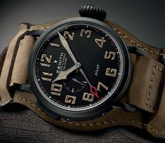 Zenith Pilot Montre d'Aéronef Type 20 GMT 1903. Zenith continues its Pilot range with the classically-styled Pilot Montre d'Aéronef Type 20 GMT 1903. Big and bold at 48mm, the large case is a titanium black DLC and houses the company's in-house Elite 693 movement. Atop the movement is a vintage-inspired dial with SuperLuminova Old Radium finish indexes and a dedicated GMT hand for travel.