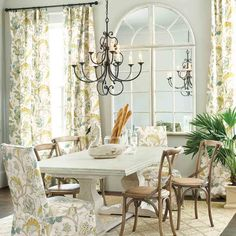 We love to take one pattern and use it in multiple places in one room. Here, we used our Courtney Floral fabric on draperies and slipcovered Parsons chairs.