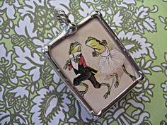 dancing frogs pendant.
