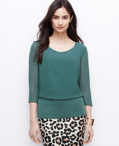 A breezy overlay make this blouse feel spring-ready