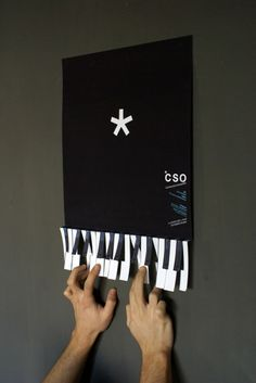 fun interactive tactile piano Flyer. would like it better if keys had info on them, and people could tear off a key and keep it to remember dates/time/etc.