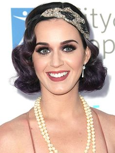 Check out Katy Perry's 1920s flapper girl look here, while we loved her frock, it was her Great Gatsby flapper-esque soft wave hairstyle that we loved more.