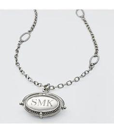 Artisan locket necklace. $64.99.  gifts.redenvelope.com