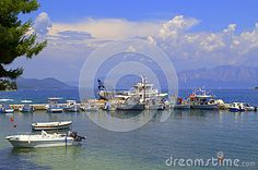 Motorboats moored at Lefkada island bay,islands and mainland landscape in the distance, beautiful summer sky and pure water,Greece