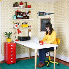 The bright and colorful home office of Etsy featured seller Wise Apple Vintage.