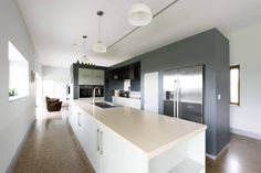 Bespoke kitchen with grey wall and white island units and polished concrete floor. Grey Kitchen Walls, Grey Walls, Passive House Design, Irish Landscape, Architectural Services, Bespoke Kitchens, Polished Concrete, Concrete Floors, Flooring