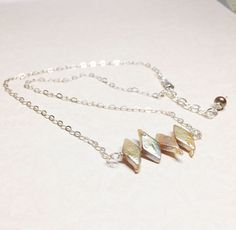 A personal favorite from my Etsy shop https://www.etsy.com/listing/510226338/pearl-bar-necklace-layering-necklace
