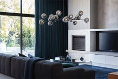 The Beacon Lighting Orion 15 light pendant in black with smoke glass