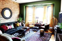 5 Must-Haves for a Boho-Chic Look. Eclectic Living Room with Green Accent Wall