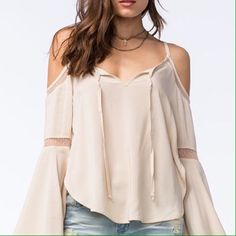 9821f525113 Cold Shoulder Top This breezy cold shoulder top was made for the free  spirit. Features long bell sleeves with mesh lace insets. Curved hem with  open slit ...