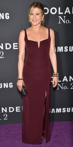 Jennifer Aniston joined her hubby Justin Theroux on the red carpet at the Zoolander 2 premiere in a burgundy Galvan corseted gown that fit her like a glove. Sidney Garber jewelry, a black clutch, and metallic Giusppe Zanotti sandals completed her look.