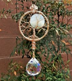 Full Moon Tree of Life crystal suncatcher from the shop LifeForceEnergy on Etsy