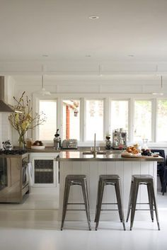 kitchens-white-counter-stools-flowers