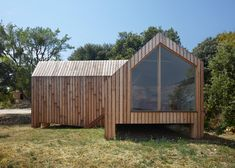 """Timber pavilion by h2o Architectes stands like a """"guardian"""" over a French vineyard."""