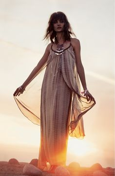 Free shipping and returns on Raga 'Aphrodite' Layered Maxi Dress at Nordstrom.com. Golden beads pepper the strappy halter neckline of a backless maxi dress. Fluttery front panels gently sweep toward the hips to the floor-grazing skirt for an elegantly tiered look.