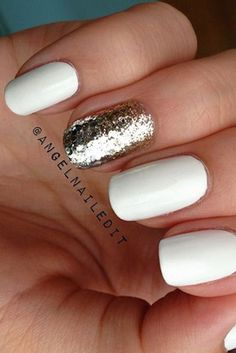 If you love a basic white manicure but want to make it more fun for the holidays, just paint one with a gold or silver metallic polish for an added dose of pizzazz. Click through for more winter nail inspo that will get you through the holidays.