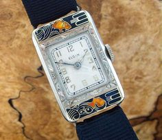 """Absolutely stunning """"Lady and the Lioness,"""" or """"Lady N' Tiger"""" Deco enamel wrist watch made for Elgin Watch Company, circa '20s. Designed by Lucien Lelong, it is arguably the finest ladies enamel wrist watch in the world. With matching 14k white gold buckle."""