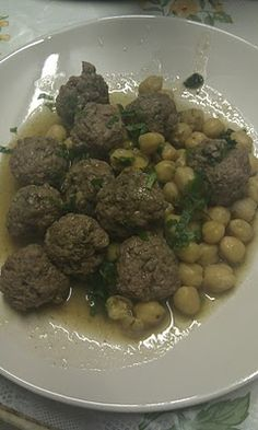 Mtewem - Algerian Garlic meatballs with chick peas! Delicious!