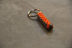 Paracord Survival Key Chain Orange and Grey by CordNinja on Etsy. Paracord Survival Key Chain - Orange and Grey.