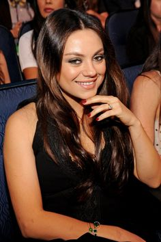 Pin for Later: Gaze on All the Gorgeous Beauty From the MTV Movie Awards Mila Kunis Mila was looking lovely with smoked-out gray eye shadow and a glittery red manicure.