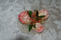 Peach Roses with gold bracelet corsage from www.wisteriashop.com