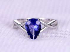Items similar to Natural Tanzanite Engagement Ring Solitaire Promise Ring White Plain Gold Blue Stone Wedding Band Personalized For her/him Custom on Etsy Tanzanite Engagement Ring, Solitaire Engagement, Engagement Rings Under 1000, Plain Gold Ring, Diamond Wedding Rings, Wedding Band, Wedding Stuff, Tanzanite Jewelry, Promise Rings