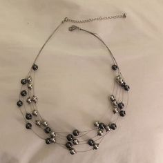 """Necklace Cute illusion necklace. Dark grey and silver beads strung on a very flexible wire. Measures 16"""" with an extension to 20"""" Jewelry Necklaces"""